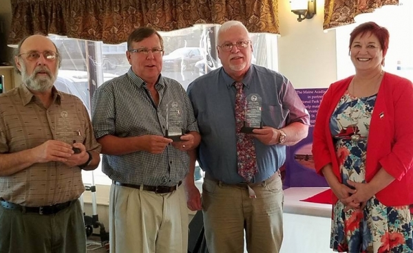 ST. AGATHA, Maine - Les Chanteurs Acadien were the recipients recently of the 2016 Maine Acadian Heritage Council Acadian Achievement Award. With their awards are, from left, Charles Stewart, Don Levesque and Roger Damboise, with MAHC President Lise Pelletier. (Contributed photo)